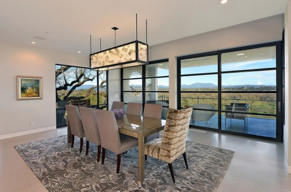 Dining Room features include window walls and slider leading to a covered terrace with Terrazzo flooring, built in heaters and views of the surrounding valley, vineyards and mountains.