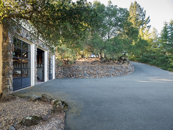 This three car garage flows seamlessly within the rest of the estate and has its own paved entry.