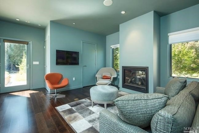 Iconic breezehouse prefab home just listed for 5 9m in for Tv room seating arrangements