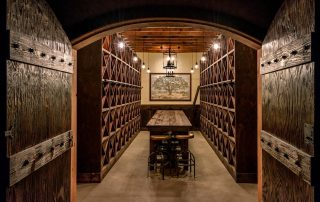 Wine cave. (Photo courtesy of Alain Pinel Realtors) Carved into the hillside is this wine cave, complete with tasting tables set up. But where do you go after all this Bacchanalian glory? Click through to see...